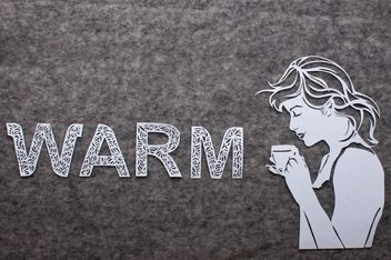 Girl with cup of coffee and word warm made of laced letters - image #327303 gratis