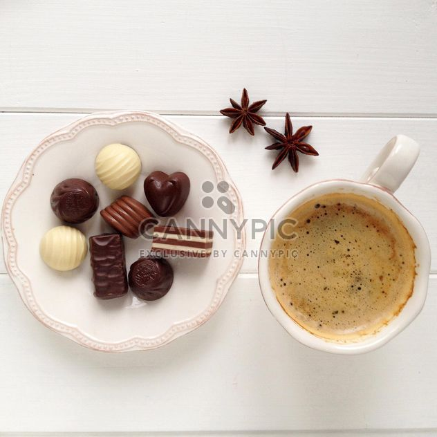 Cup of coffee, candies and anise - image gratuit #329093