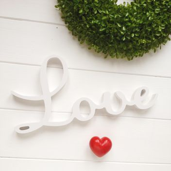 Red heart, word Love and green wreath on white background - бесплатный image #329293