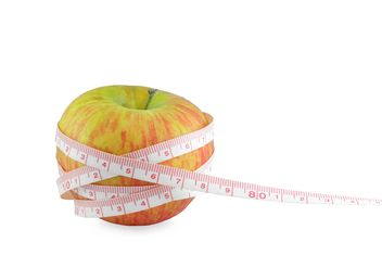 Ripe apple and measuring tape - image gratuit #329653