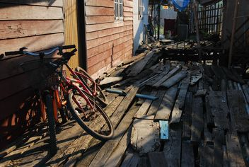 Bicycles near old wooden hut - бесплатный image #330333