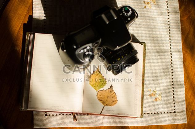 Nikon f60 with book and autumn yellow leaves - Free image #330393
