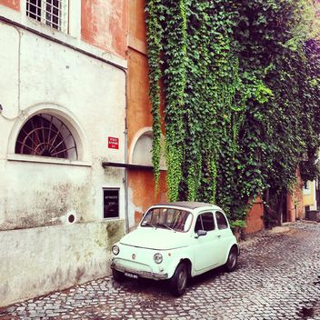 White Fiat 500 parked near old building - image gratuit #331913