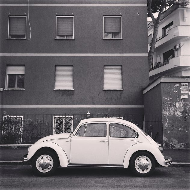 Old Volkswagen car near the house, black and white - Free image #331953
