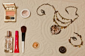 Cosmetic with the sands background - image gratuit #333233