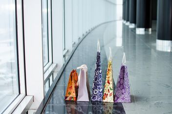 Shopping bags near windows - image #338263 gratis