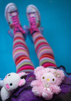 Girl in colorfull tights with soft toys - бесплатный image #342123