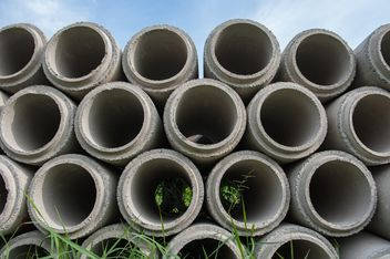 Concrete drainage pipes stacked on construction site - Free image #344583