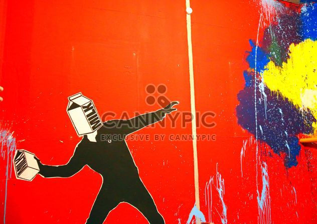 Bright graffiti on red wall - Free image #345113