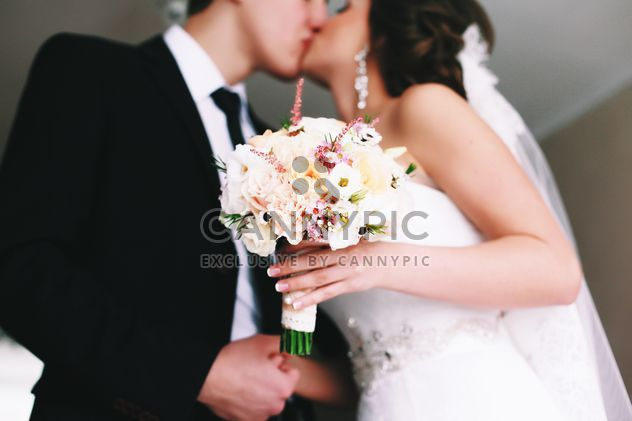 Happy wedding couple kissing - Free image #345883