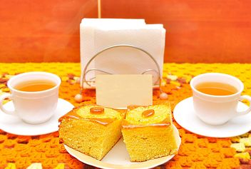 Two cups of tea and cakes on table - бесплатный image #346553