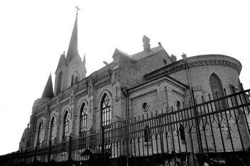 Old church behind fence, black and white - бесплатный image #346613