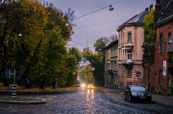 Houses and cars on street in autumn - бесплатный image #346913