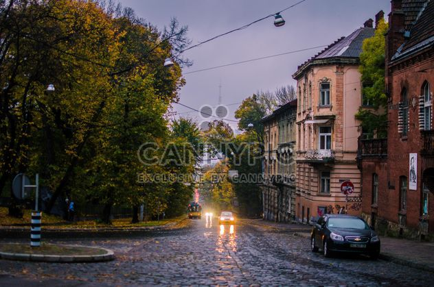 Houses and cars on street in autumn - Free image #346913