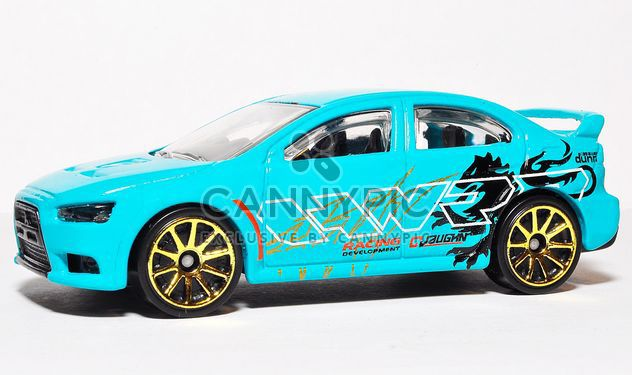 Small model of blue automobile on white background - Free image #346933