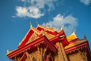 Thai temple against blue sky, view from below - бесплатный image #347193