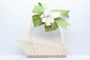 White wicker basket on white background - image gratuit #347233