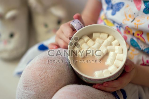 Cup of cocoa with marshmallows in child's hands - Free image #347963