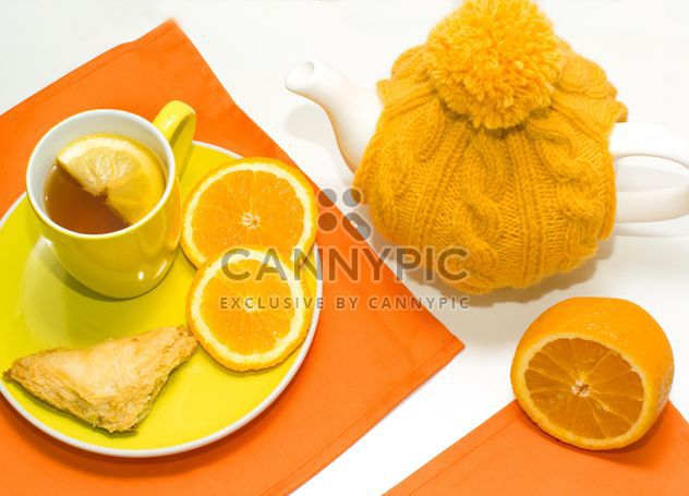 Tea with lemon and teapot in knitted hat - Free image #347973