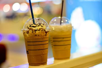 Coffee with ice in plastic cups - бесплатный image #380503