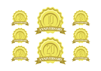 Anniversary celebration golden labels and badges - Free vector #409923