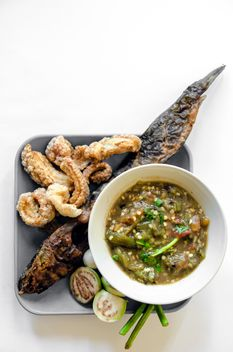 Thai food, streaky pork with crispy crackling and grilled catfish - image #452493 gratis