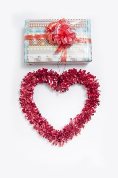 Decorated gift box and heart on white background - бесплатный image #452553