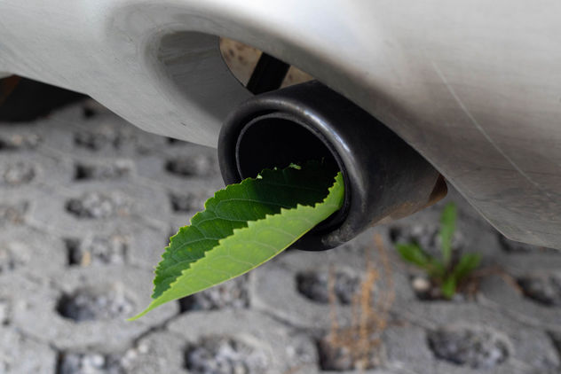 Fuel efficient car muffler with a green leaf - бесплатный image #455133