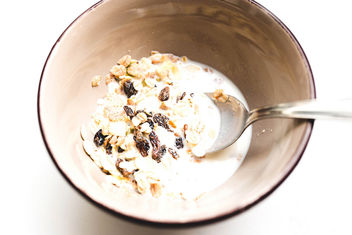 Close up of raisin oat muesli and milk in a bowl.jpg - Free image #458023