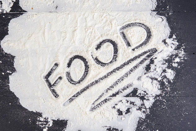 Word-Food-on-the-spilled-flour-on-the-black-table.jpg - image #462273 gratis